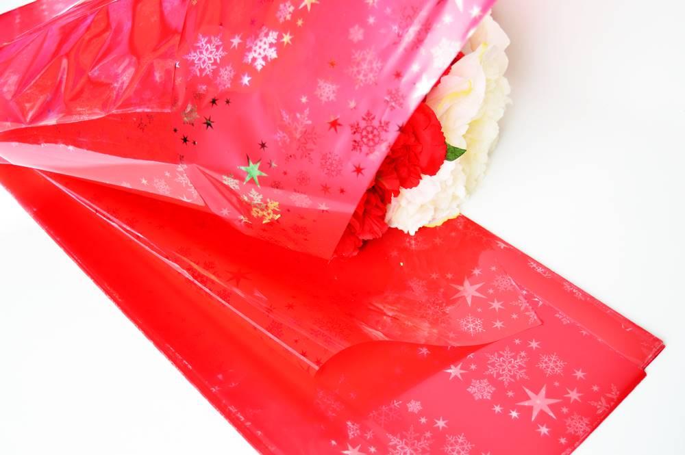 Ambalaje Flori ONLINE vinde Celofan Color Stelute Rosu la pretul de 8.9 lei